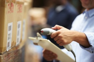 Man in warehouse scanning a box