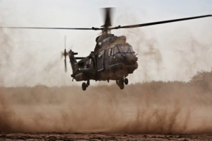 Military Helicopter landing in a desert