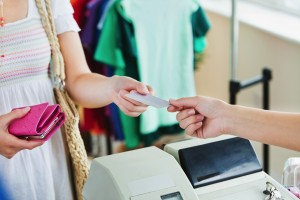 Customer paying at the cash register with a credit card